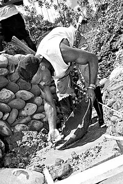 man-sifting-for-gold-250